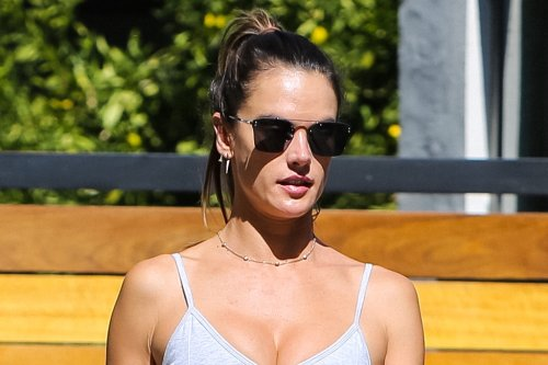 Alessandra Ambrosio Does Athleisure Neutrals in Gray Sports Bra & White Biker Shorts With Matching Sneakers