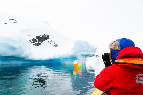 Travel Photographer Sent Scrambling When Iceberg Flipped Mid-Shot