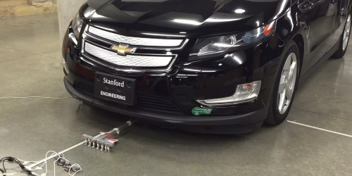Watch This Team of Six Tiny Robots Move a Car