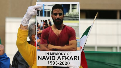 Iranian athletes at Tokyo Olympics remember murdered wrestler Navid Afkari