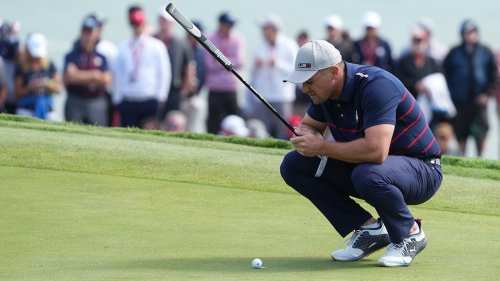 Bryson DeChambeau stares down Europe Ryder Cup team after having to hole out