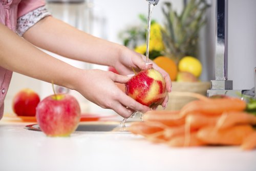 Does rinsing fruit before you eat it actually do anything?