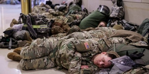 Early-morning Capitol photos show National Guard troops resting ahead of impeachment debate