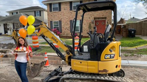 Woman celebrates year of unfinished construction in front of New Orleans home