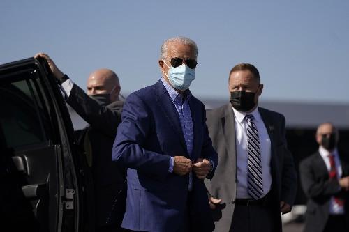 Leading Trump in polls, Biden tries to run down the clock