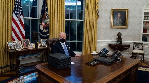 President Biden appears to remove Trump's Diet Coke button from Oval Office