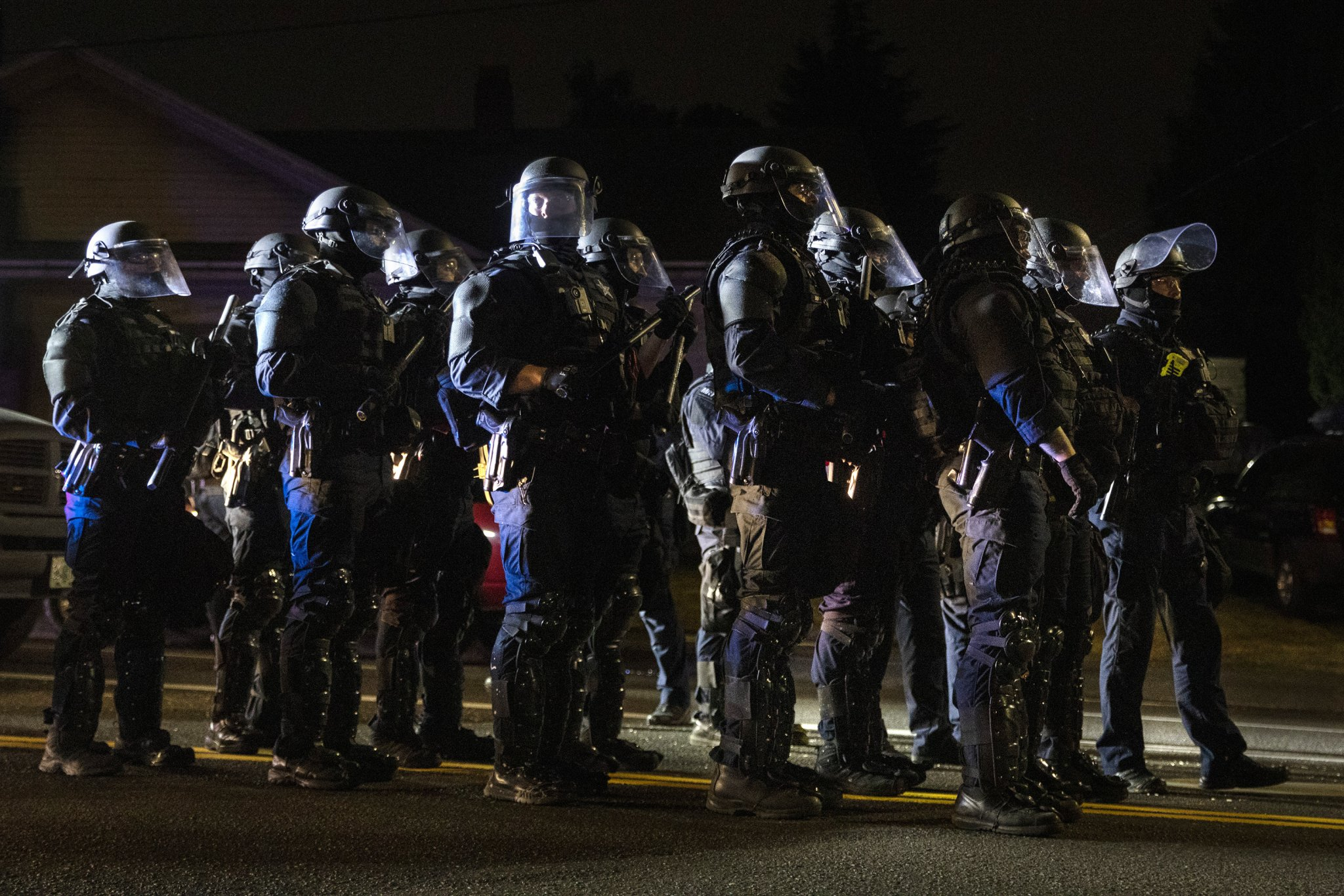 Portland police declare riot after protesters march on mayor's residence