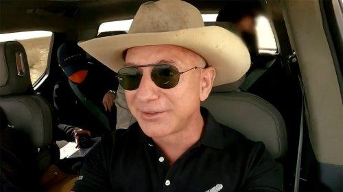 Watch: Jeff Bezos drives electric Rivian pickup to Blue Origin landing site