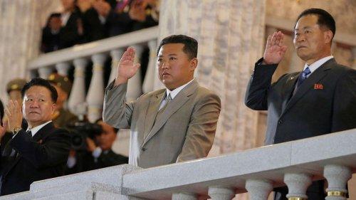 North Korea, slimmed-down Kim Jong Un, enjoy toned-down parade