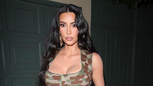 Kim Kardashian shares her 'resting beach face' as she poses in a thong bikini