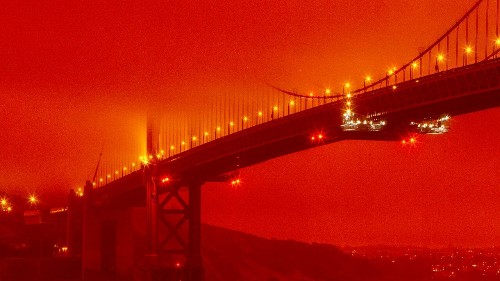 California woman blasted online for wearing orange dress in beach photos during the West Coast wildfires