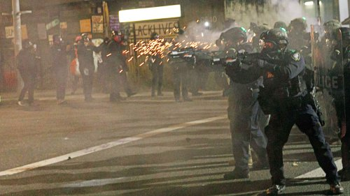 Portland's police riot team resigns after officer indicted over alleged assault on photographer