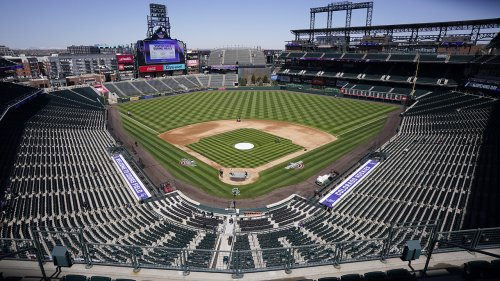 Padres fan delivers brutal right hook to spectator at Coors Field