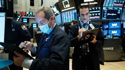 Stock futures fall ahead of sobering economic reports