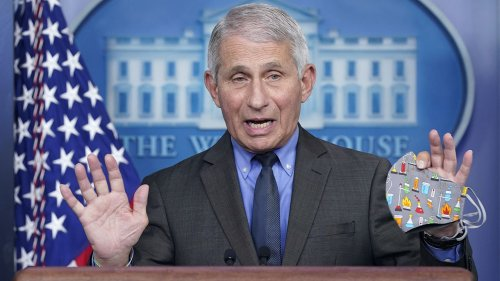 Fauci, pressed on why vaccinated people still need to wear masks, hints change is coming