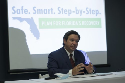 Florida governor encourages people to visit on commercial flights as coronavirus cases decrease