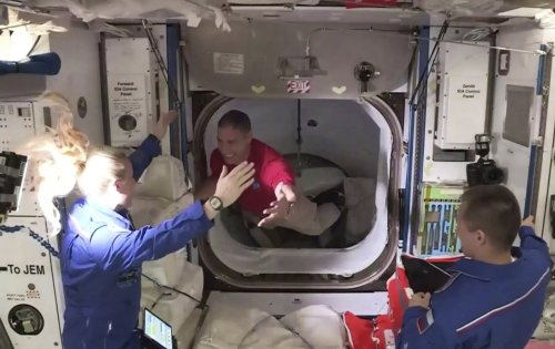 NASA astronauts become latest space station residents in historic SpaceX Crew Dragon mission