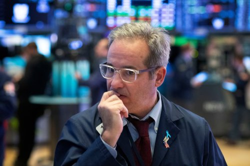 Dow falls 510 points curbs losses as tech stocks recover