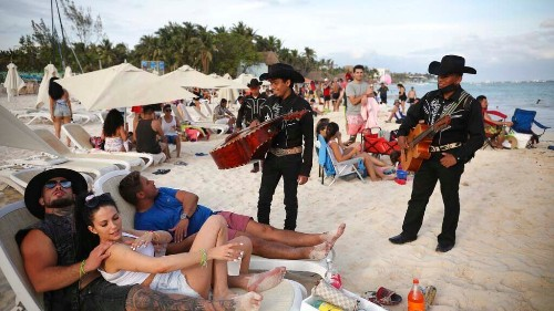 Mexico sees tourism bump as pandemic surges