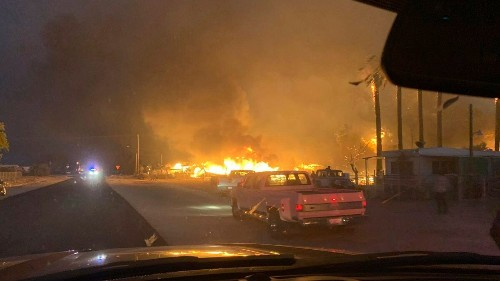California wildfire destroys dozens of homes in desert town, leaves 1 dead