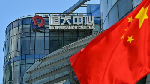 Beleaguered property giant Evergrande makes key offshore interest payment