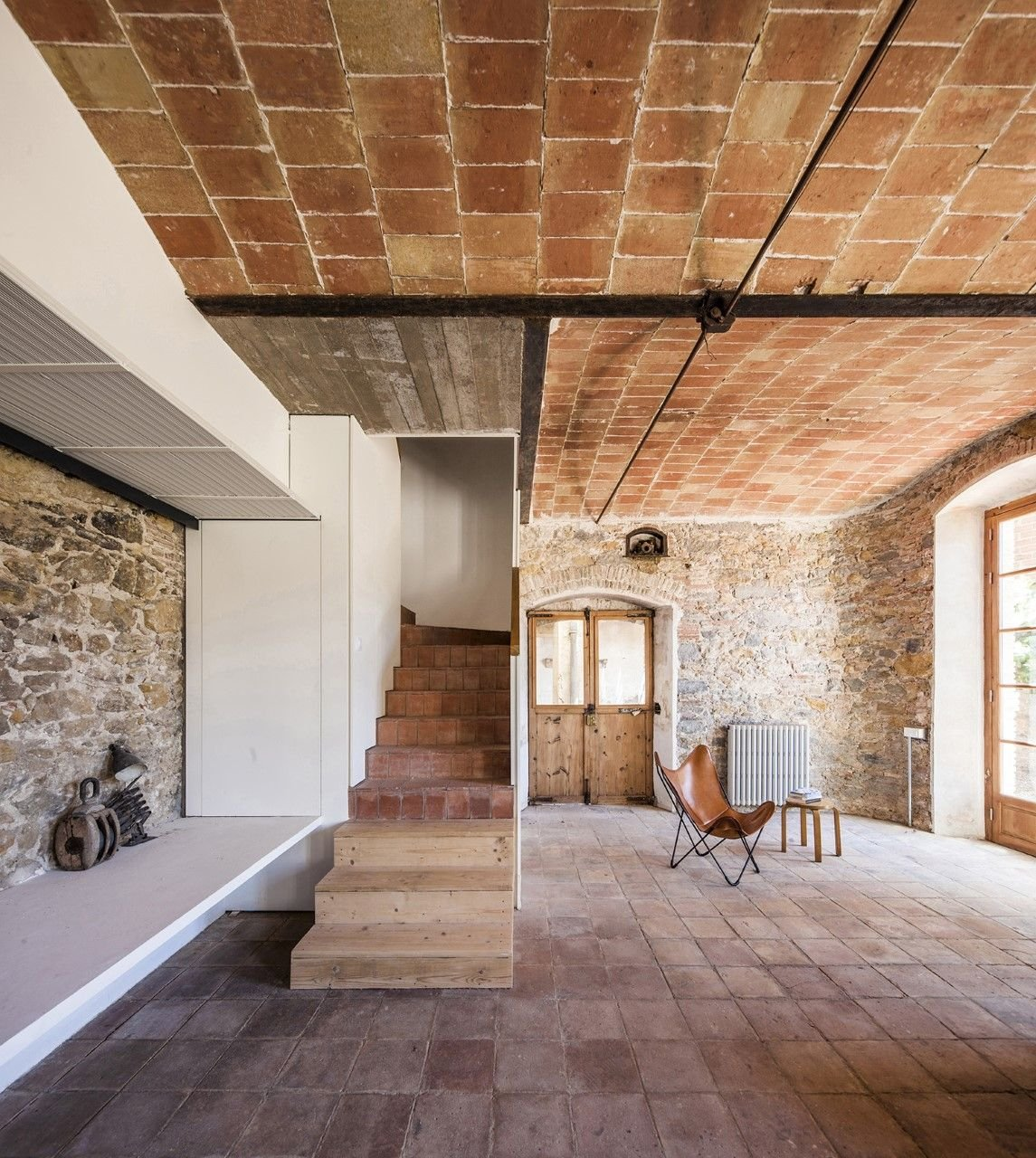Explore a converted chocolate factory with rustic, industrial-style interiors