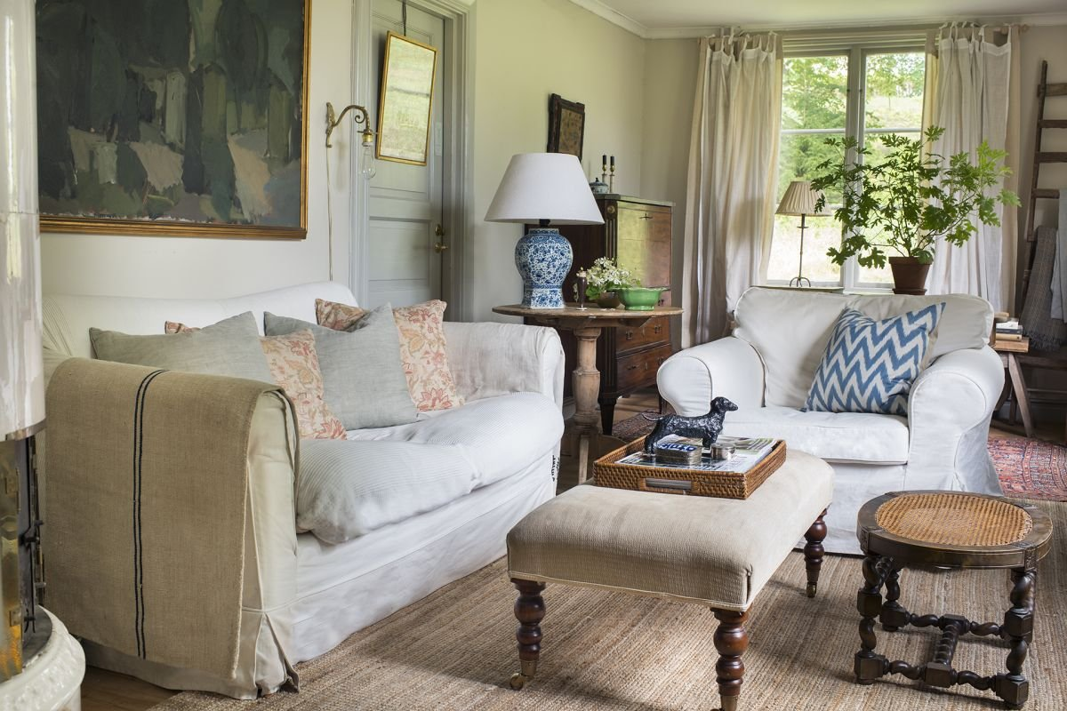 Step inside this elegant Swedish country home full of antiques and creative flair