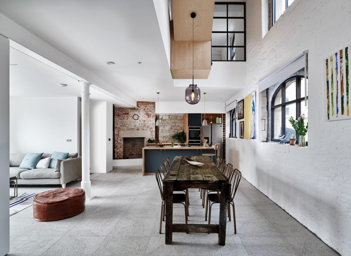 See how a Grade II-listed wine warehouse in an old mill town became a modern, four-bedroom home