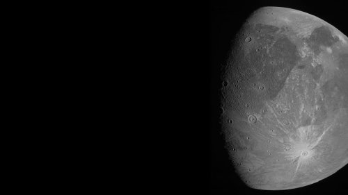 Jupiter's Ganymede, the largest moon in the solar system, looks amazing in these 1st photos from NASA's epic Juno flyby