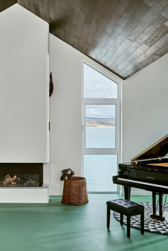 Explore this modern beach house in Ireland with floor-to-ceiling sea views