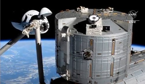 A piece of space junk zipped by SpaceX's Dragon capsule on its way to the space station