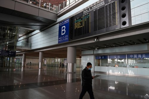 Why is China giving travelers anal tests for COVID-19?