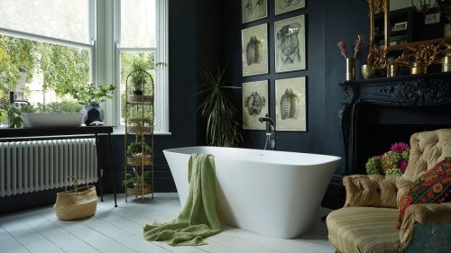 If a black bathroom isn't for you, opt for a dark green this season