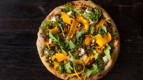 Up your pizza oven game with this pesto and burrata pizza recipe