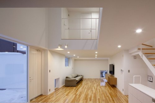 House-K: A Two-Household Home with A Bright and Warm Interior