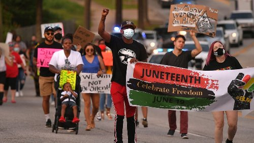 Biden signs Juneteenth into a holiday, officially giving federal employees the day off Friday