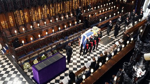 Queen Elizabeth II sits alone at Prince Philip's funeral, family says farewell at St. George's Chapel
