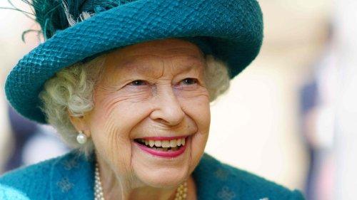 Mind how you go: Queen Elizabeth strolls the cobblestones on visit to 'Coronation Street' set