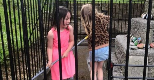 Dedicated young sisters spend morning cleaning up cenotaph