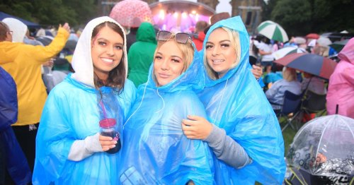 Pictures of partygoers in ponchos at the return of Summer Sound