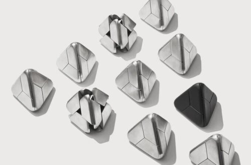 Tetra mechanical puzzle consist of four identical pieces