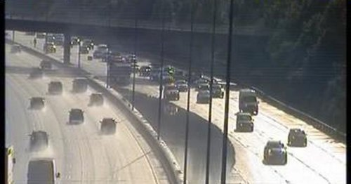 Live: M25 lanes closed after flooding in Surrey