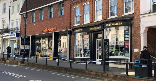 Police cordon outside Sainsbury's store in Surrey as shops shut
