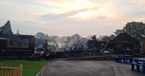 Firefighters spend hours tackling huge fire at Surrey school