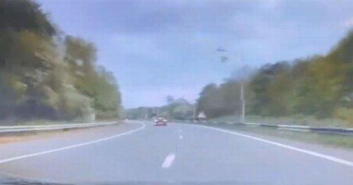 Warning after car 'reverses towards oncoming traffic' on motorway