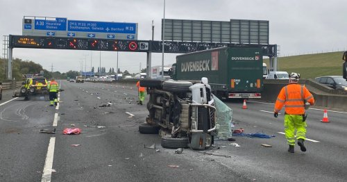 Heavy M25 traffic as emergency services attend overturned car