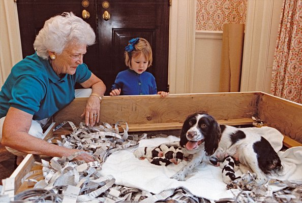 First Lady Barbara Bush with her granddaughter and Millie