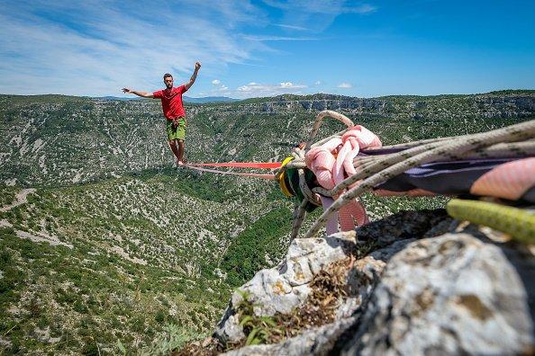 Acrobats walk the longest slackline ever in France
