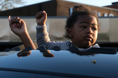 A child holds up her fist in Columbus