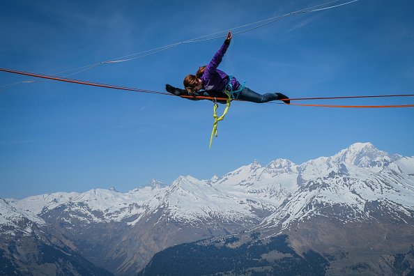Splits on a highline over the French Alps